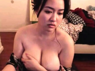 Hot Asian milf with big boobs enjoys a fuck