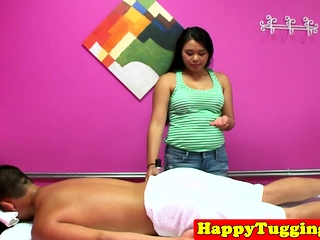 Adorable asian masseuse blowing customers cock